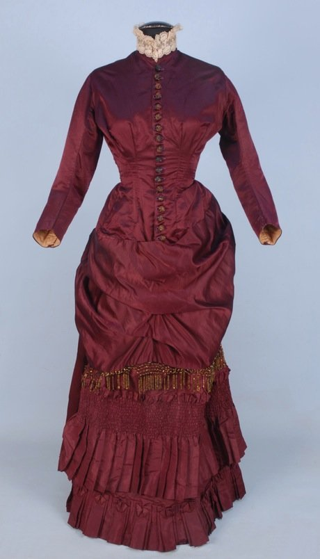 SILK BUSTLE DRESS with BEADED TRIM, c. 1880.