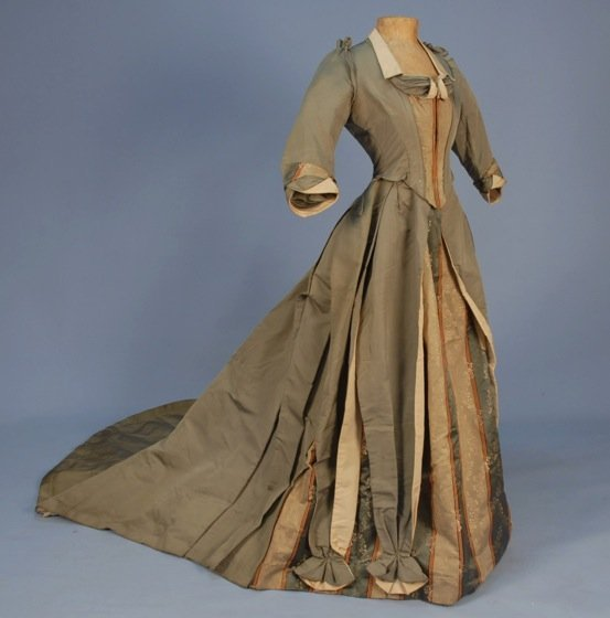 TRAINED FAILLE and BROCADE RECEPTION GOWN, c. 1888.