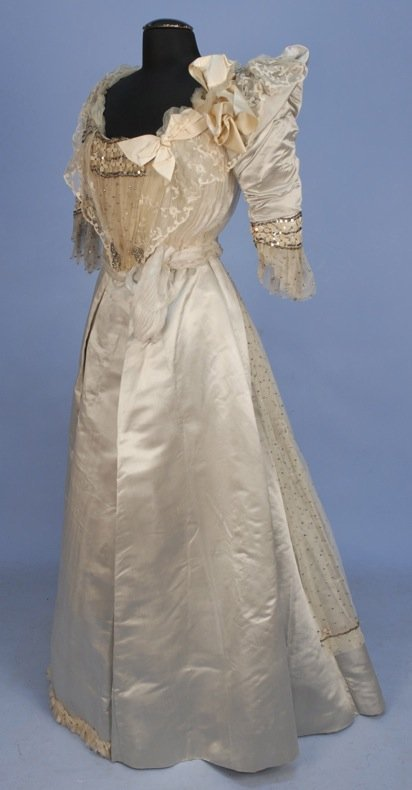 SILVER SEQUINED SILK EVENING GOWN, 1890's.