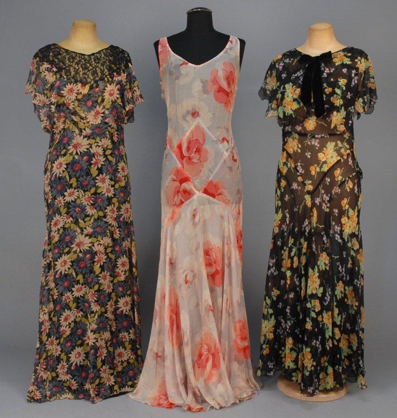 THREE FLORAL PRINTED CHIFFON SLEEVELESS DRESSES, 1930s.
