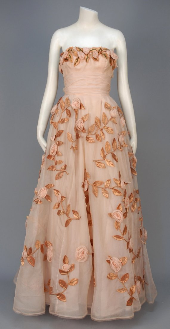 STRAPLESS BALL GOWN with FLORAL APPLIQUE, 1950s.