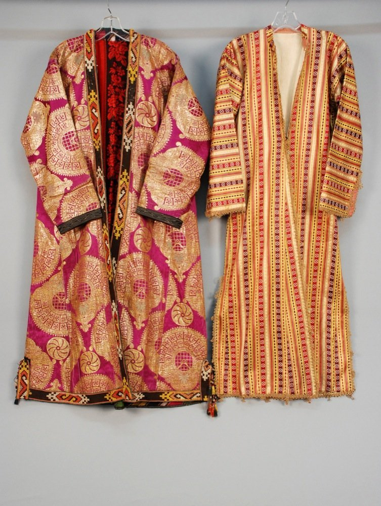 TWO ETHNIC SILK ROBES, 20th C. Probably central Asian:
