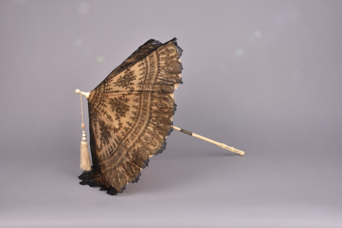 LACE CARRIAGE PARASOL with CARVED IVORY HANDLE, 19th C