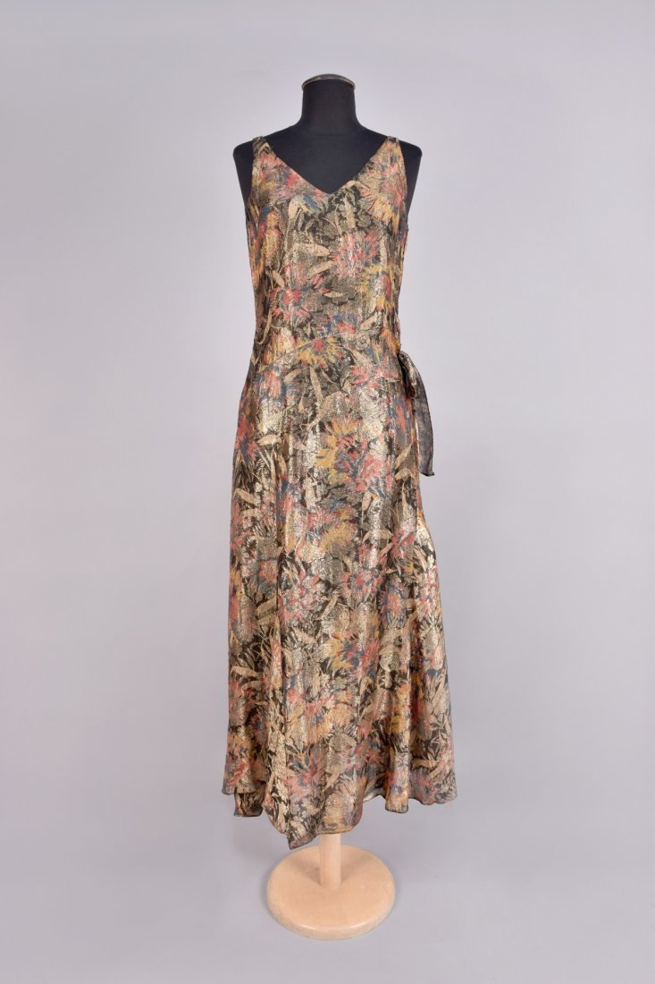 PRINTED and METALLIC BROCADE GOWN, 1930s.