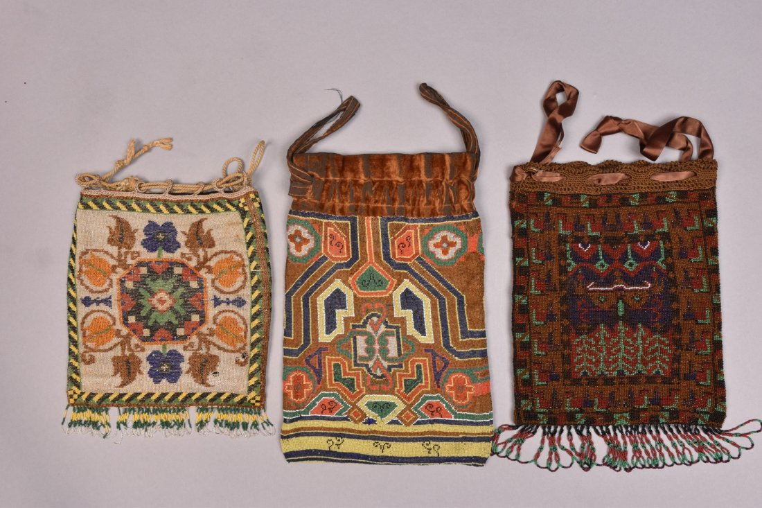THREE LARGE CARPET DESIGN MICRO-BEADED BAGS, EARLY 20th