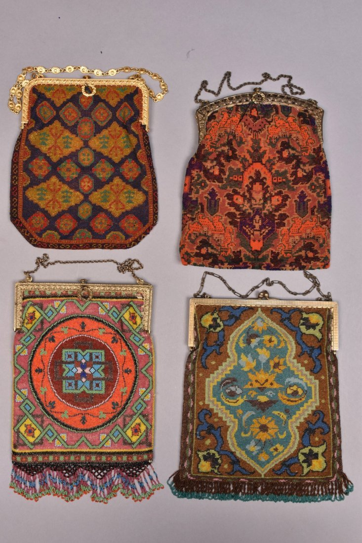 FOUR CARPET DESIGN BEADED BAGS, 1920s.