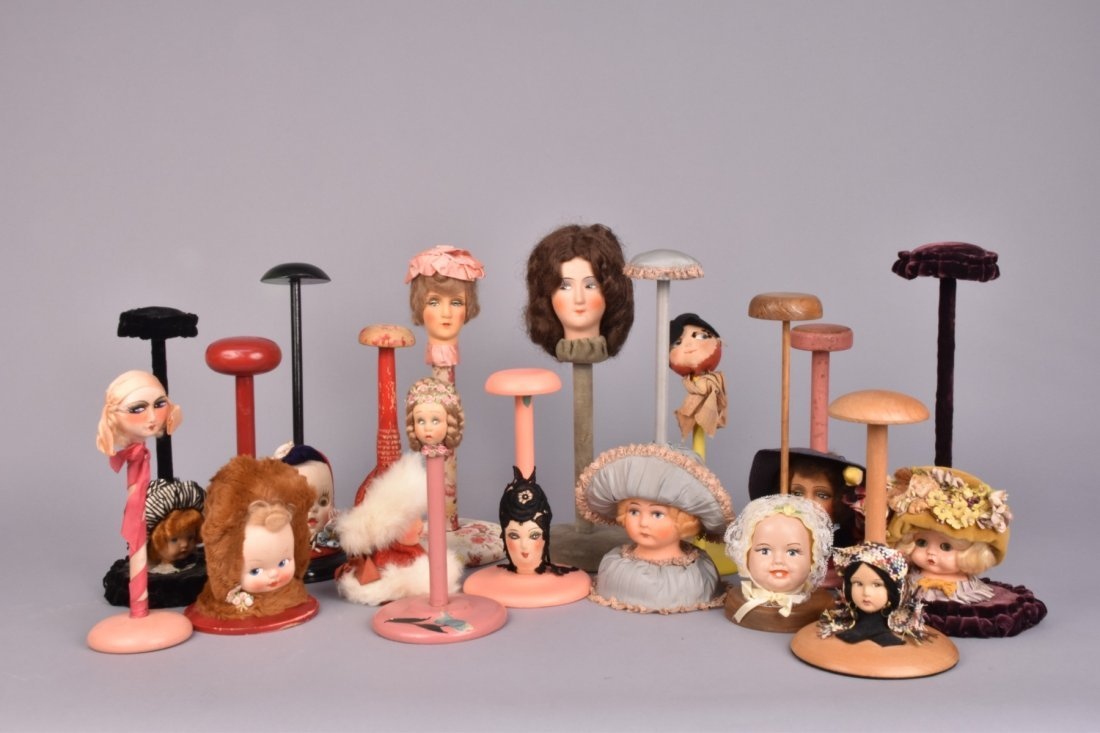 FIFTEEN FIGURAL HAT STANDS, c. 1930