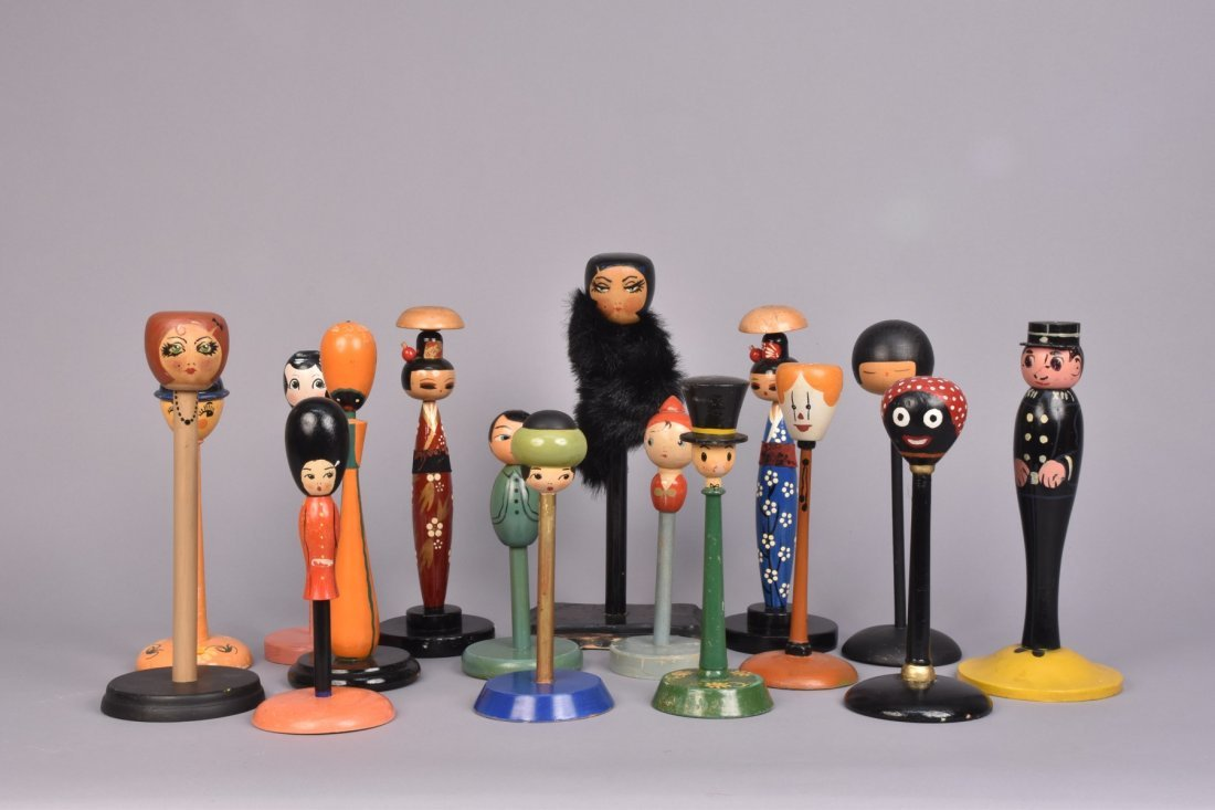 SIXTEEN FIGURAL HAT STANDS, c. 1930