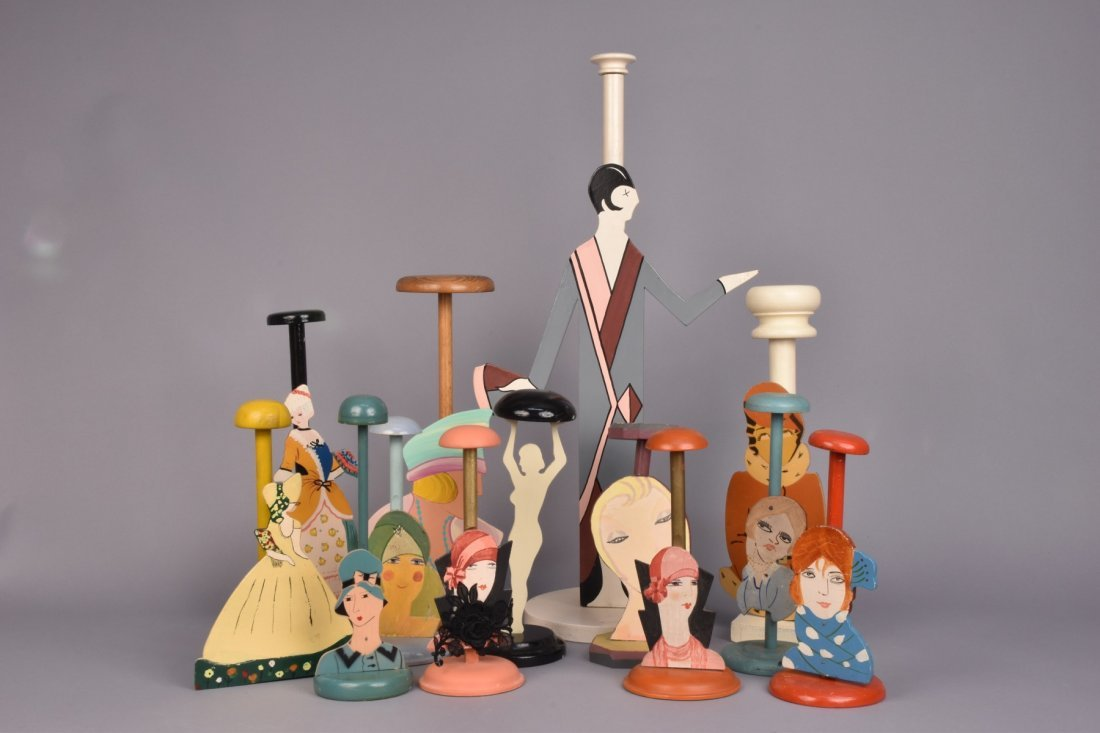THIRTEEN FIGURAL HAT STANDS, c. 1930