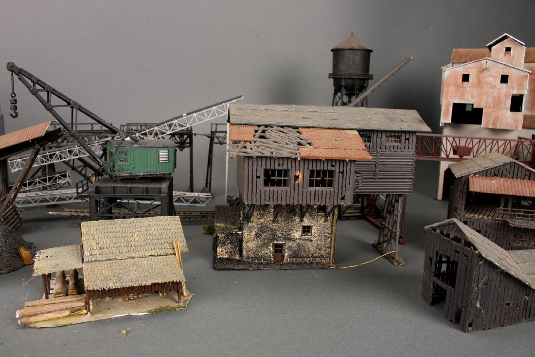 COLLECTION OF MODEL TRAIN BUILDINGS - 6