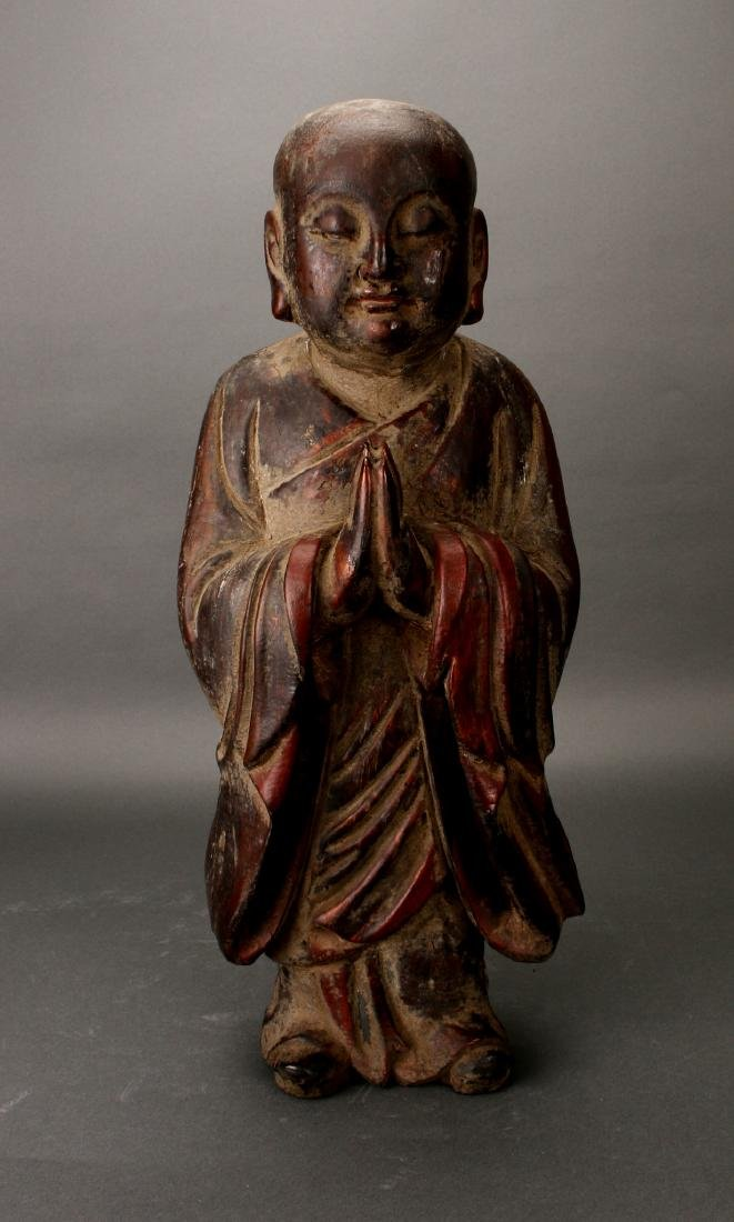 CARVED WOODEN PRIEST