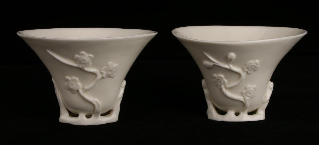 PAIR OF PORCELAIN RHINOCEROS FORM LIBATION CUPS