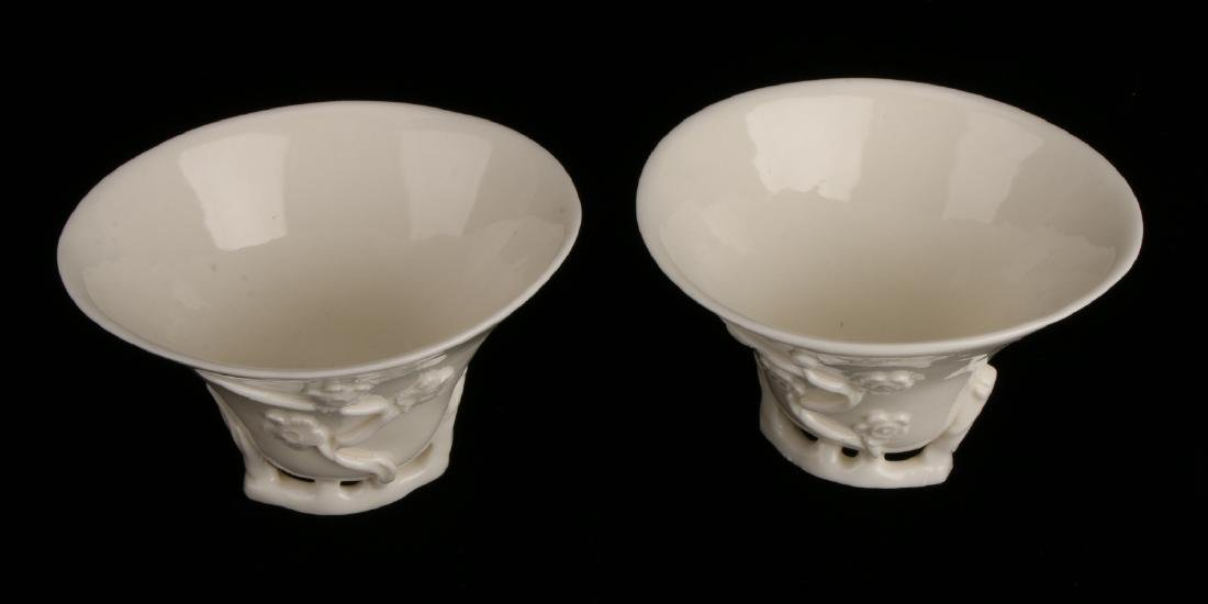 PAIR OF PORCELAIN RHINOCEROS FORM LIBATION CUPS - 6