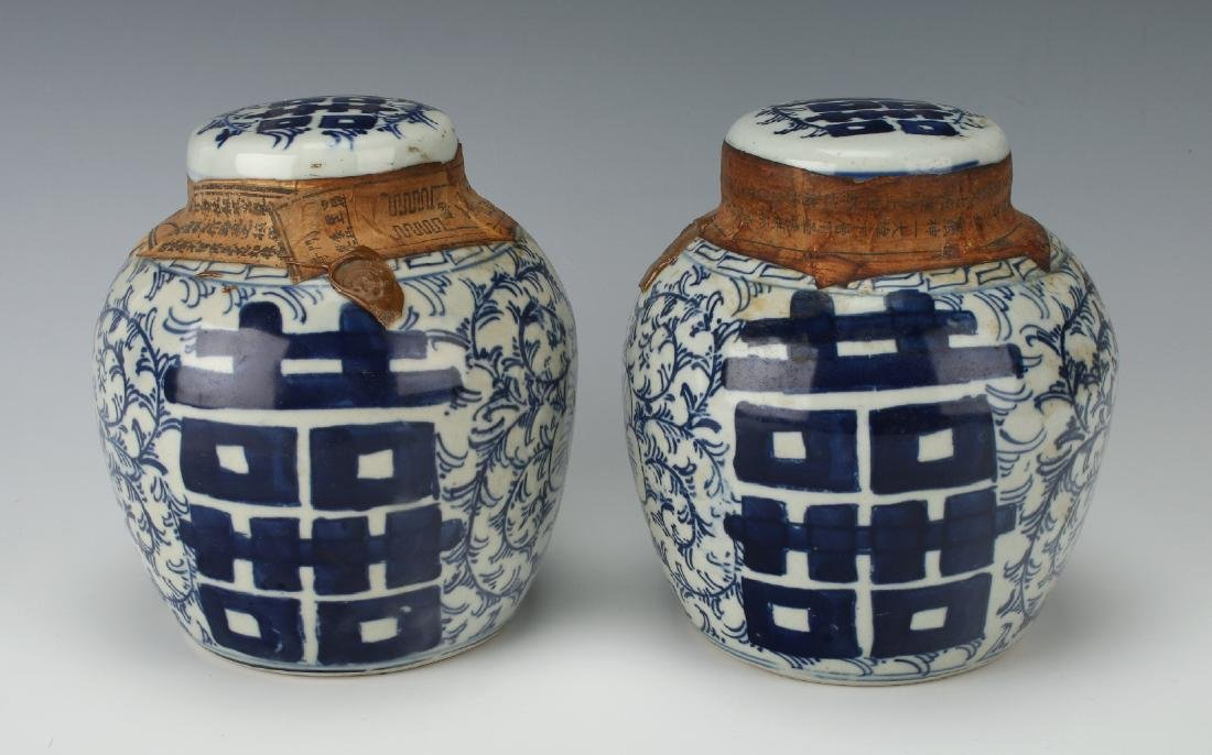 PAIR OF SEALED BLUE AND WHITE JARS