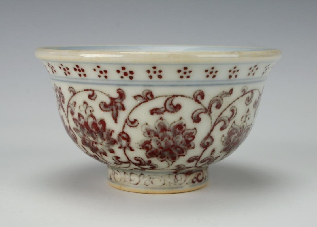 PORCELAIN TEA CUP WITH RED FLORAL MOTIF