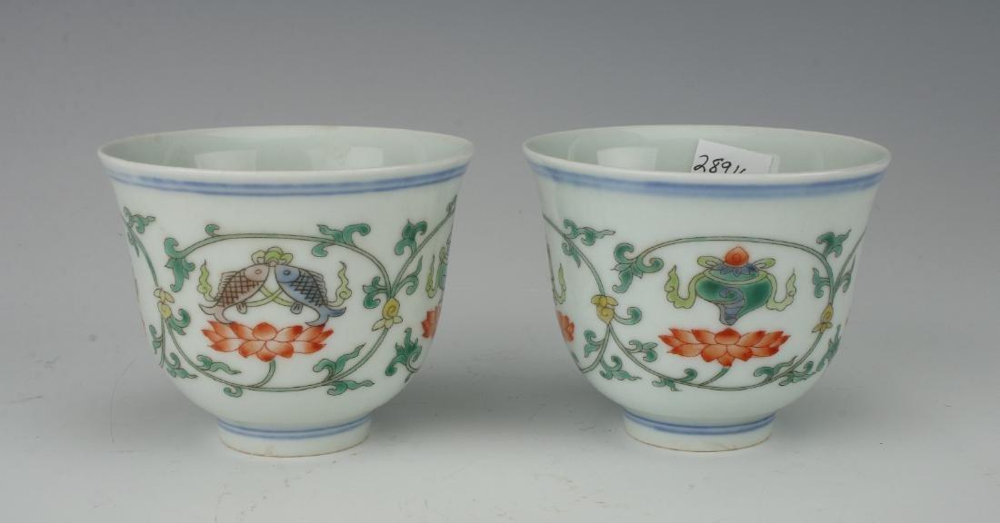 PAIR OF TEA CUPS