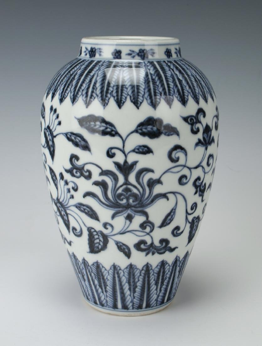 BLUE & WHITE VASE WITH FLORAL MOTIF