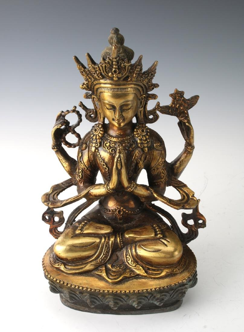 BRONZE FOUR-ARMED BUDDHA