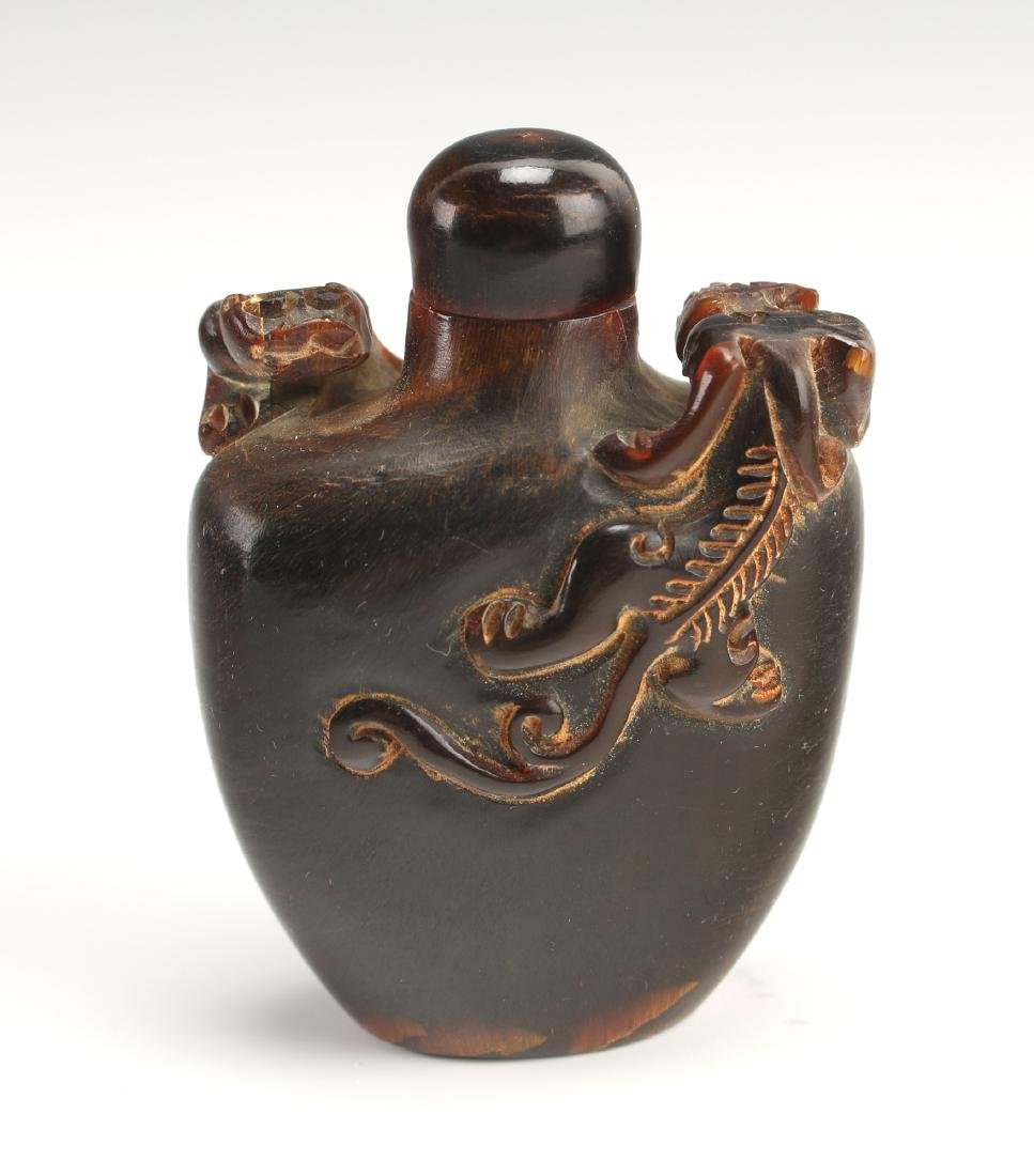 CARVED OX HORN SNUFF BOTTLE WITH DRAGONS