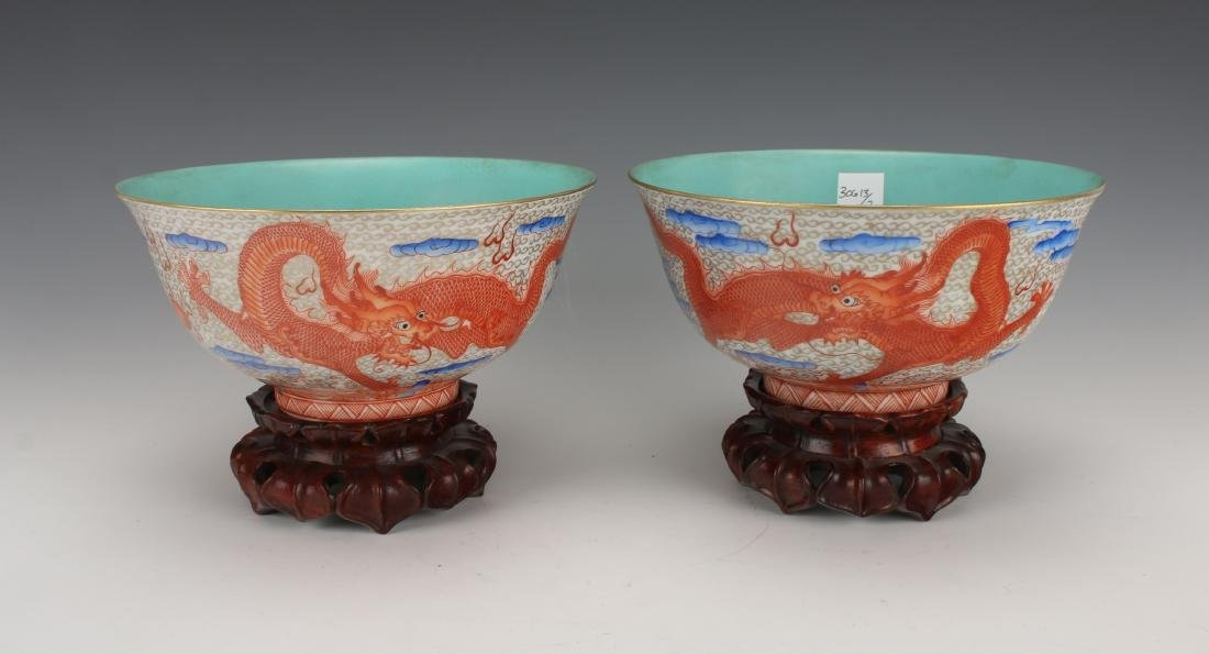 PAIR OF DRAGON BOWLS ON WOODEN STANDS