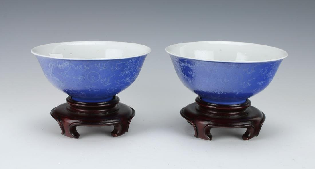 PAIR OF BLUE DRAGON BOWLS ON WOODEN STANDS