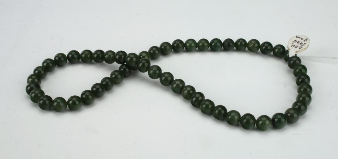 STRAND OF SPINACH GREEN JADE BEADS