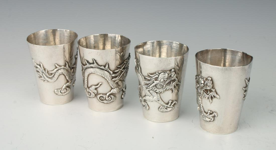 FOUR CHINESE EXPORT SILVER SHOT GLASSES