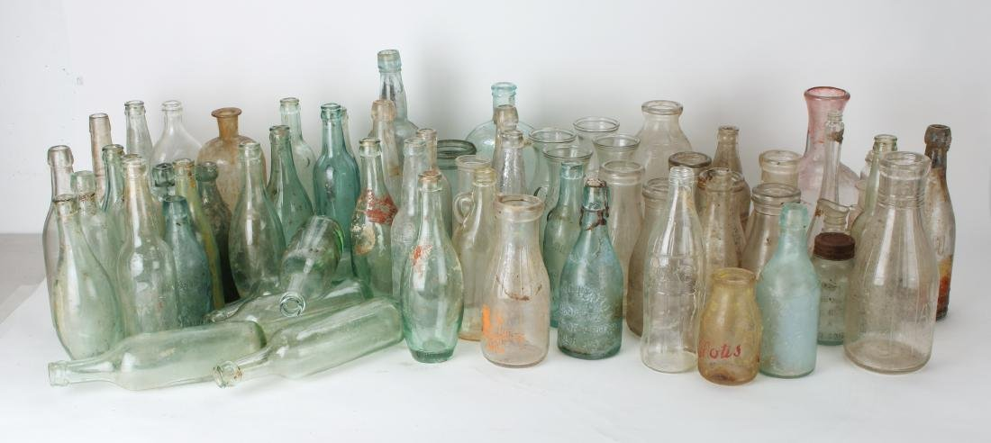 LARGE LOT OF ANTIQUE BOTTLES INC MILK/BEER/SODA
