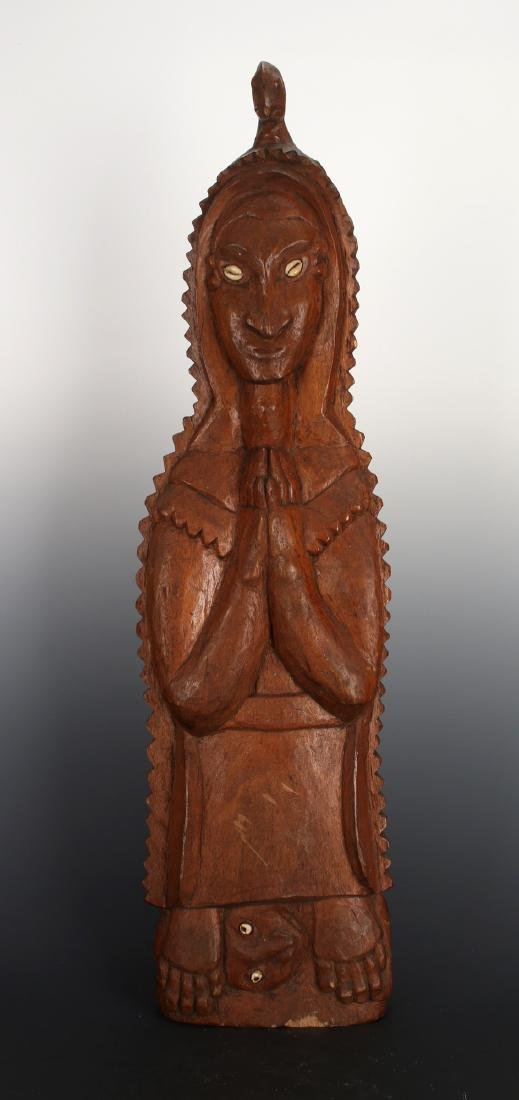 SOUTH PACIFIC PRAYER STATUE