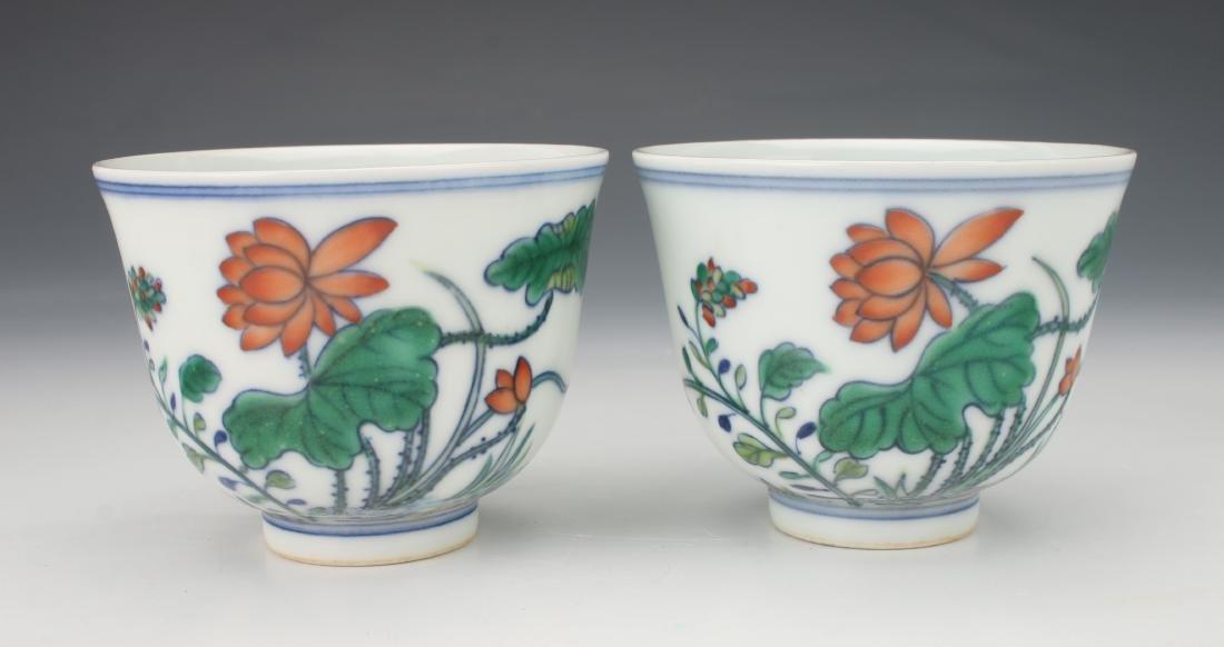 PAIR OF YONGZHENG DU CAI FLOWER TEA CUPS
