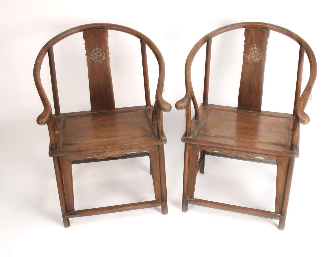 PAIR OF HUANGHUALI HORSESHOE CHAIRS