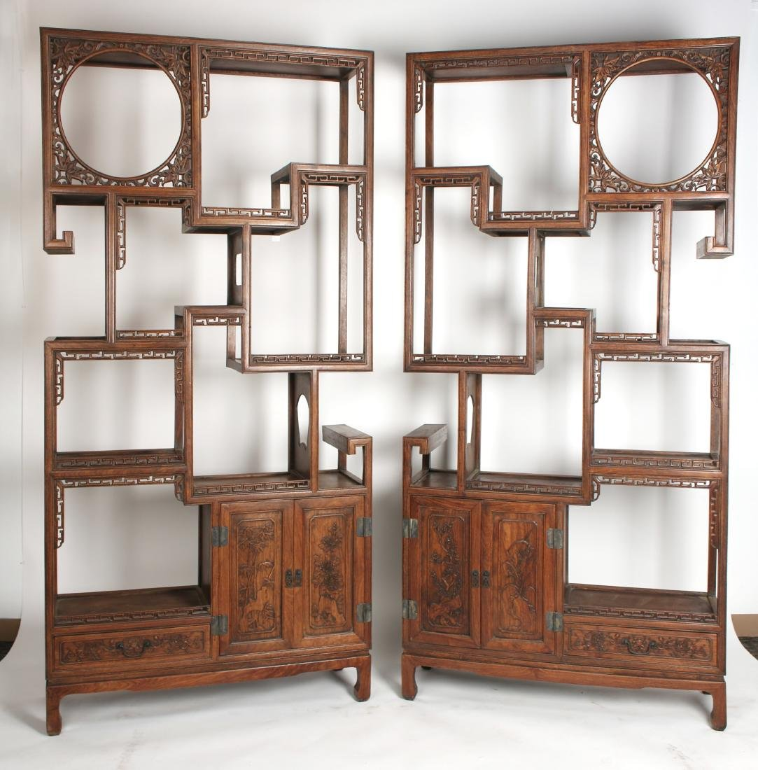 PAIR OF MIRRORED CARVED HUANGHUALI SHELVES