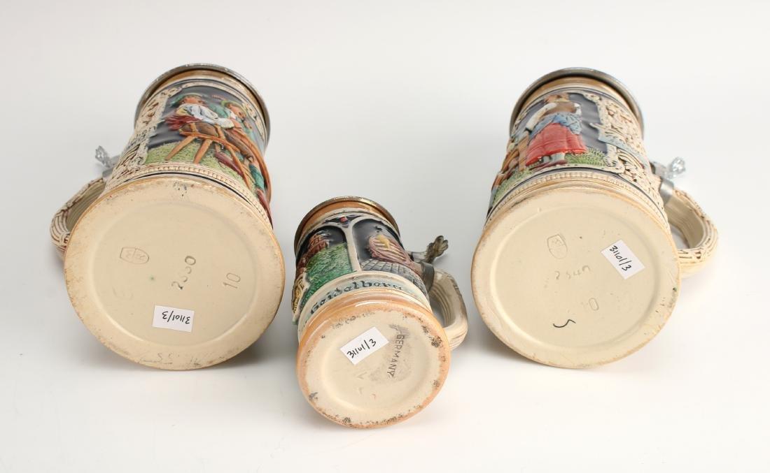 THREE GERMAN BEER STEINS - 6