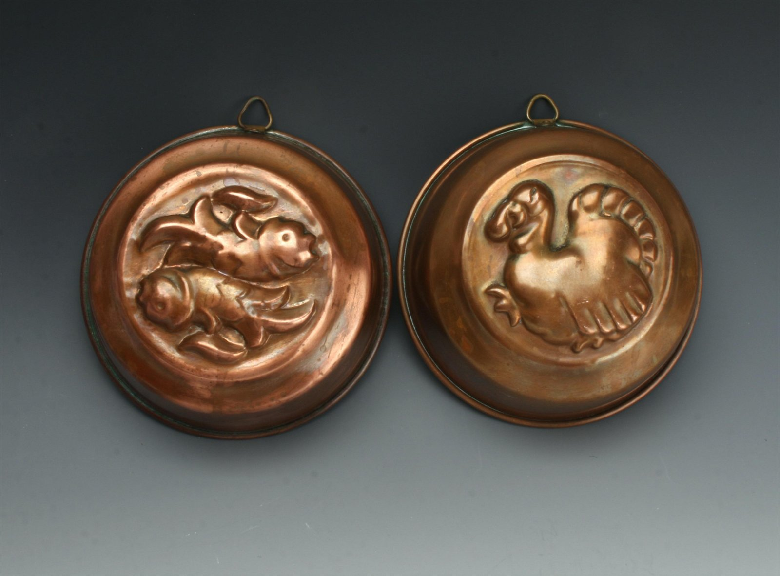 TWO VINTAGE COPPER MOLDS