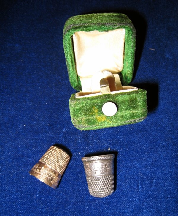 16: A silver and gold thimble