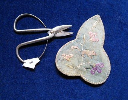 17: Sewing scissors within an embroidered case