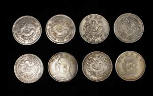 SLEEVE OF EIGHT CHINESE COINS