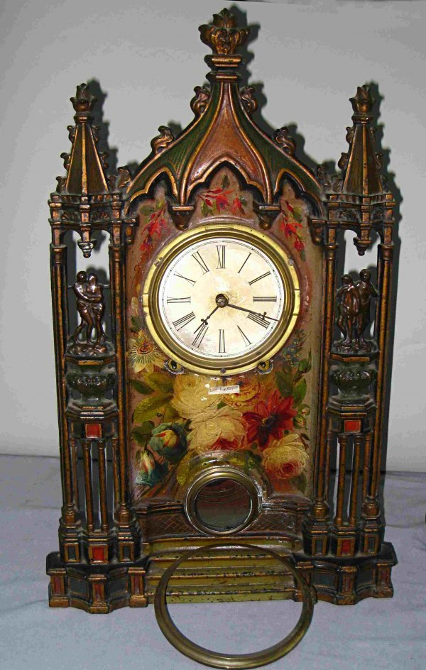 1: Two Iron Front clocks