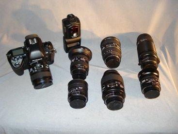196: Nikon camera and multiple lenses