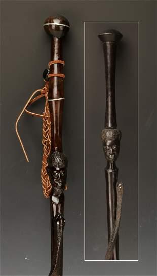 TWO CARVED ETHNIC SNAKE WALKING STICKS CANES
