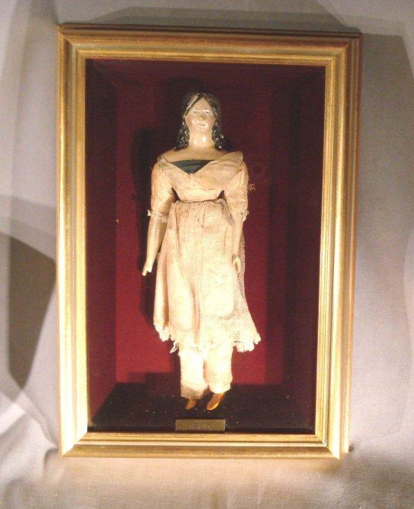 109: Antique doll