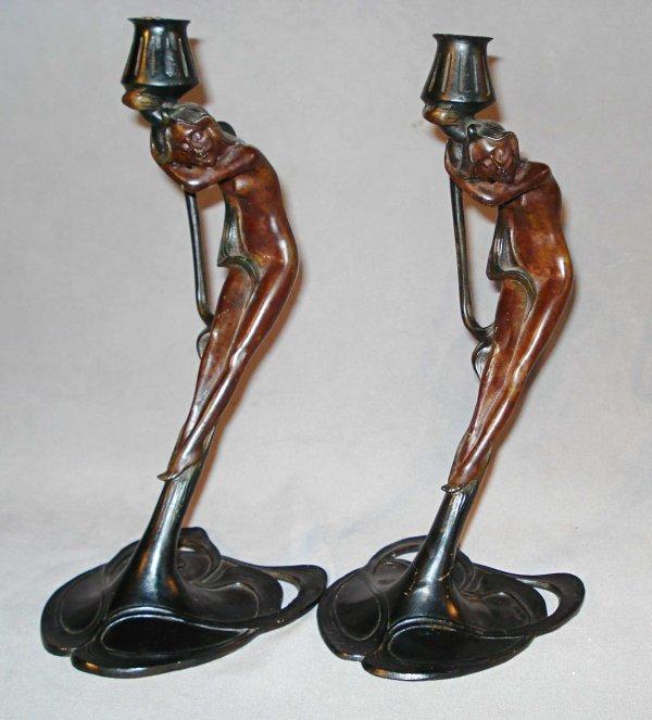 16: Pair of art nouveau candlesticks
