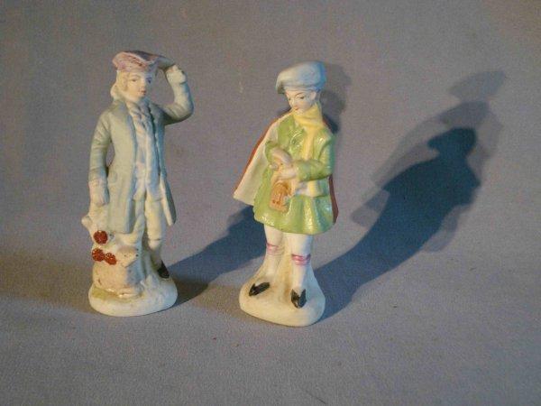 16: Pair of biscuit figurines