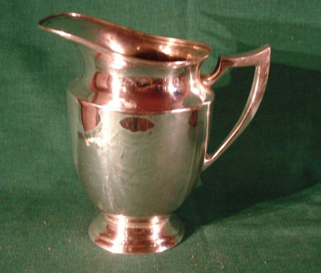 18: Silver water pitcher