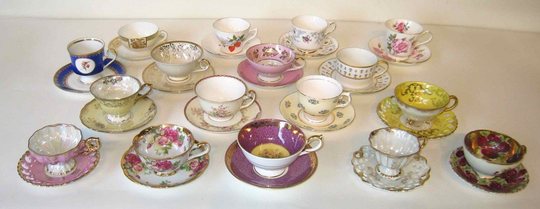240: 17 porcelain tea cups and saucers