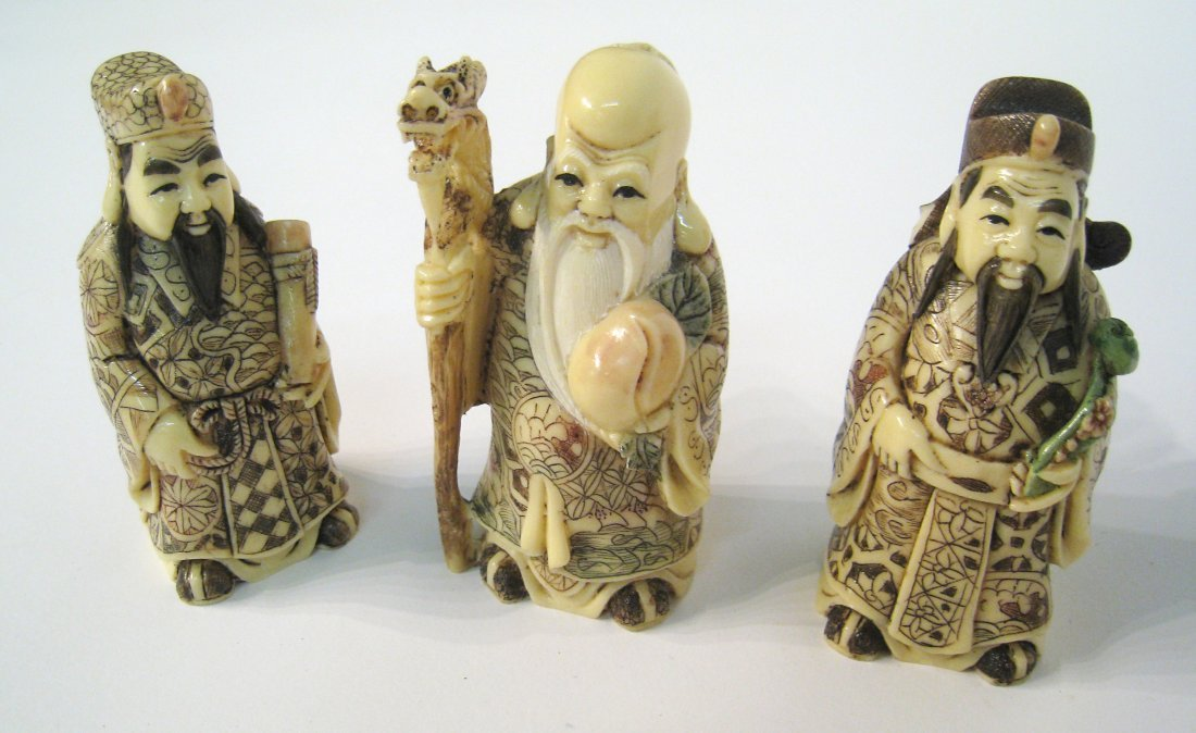 67: Three Carved Ivory Figures