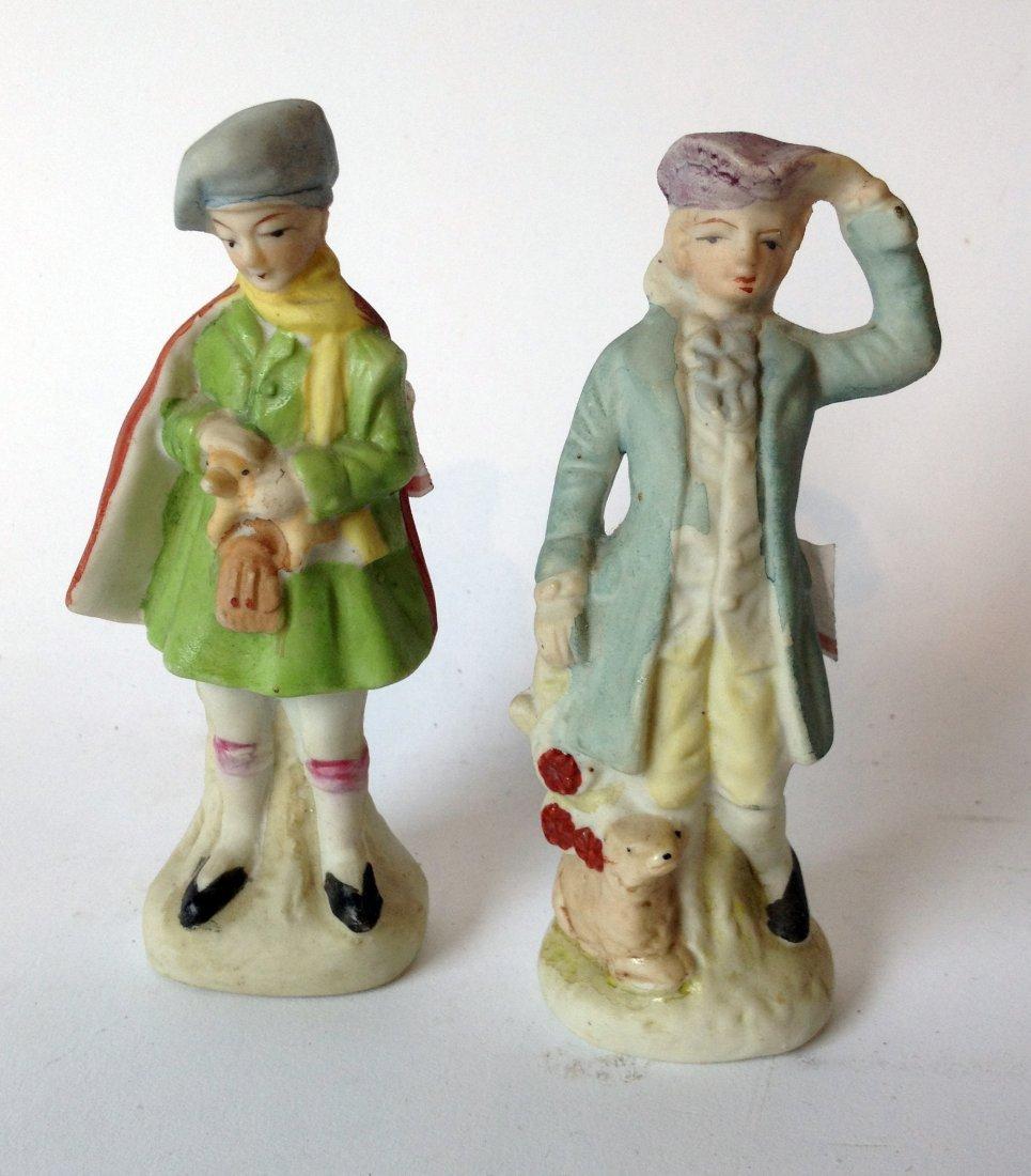 Pair Of Biscuit Figurines