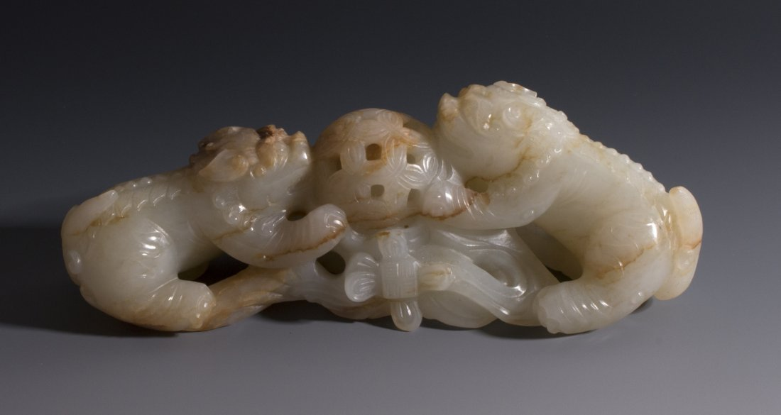CHINESE CARVED WHITE JADE FOO LIONS