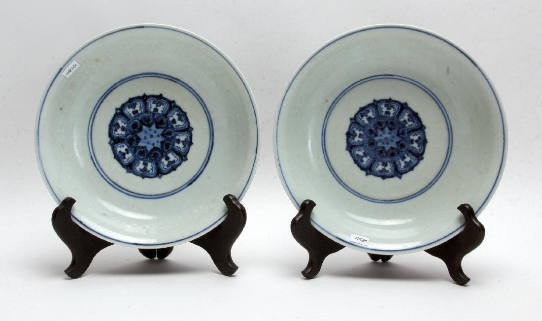 TWO BLUE AND WHITE LOW BOWLS