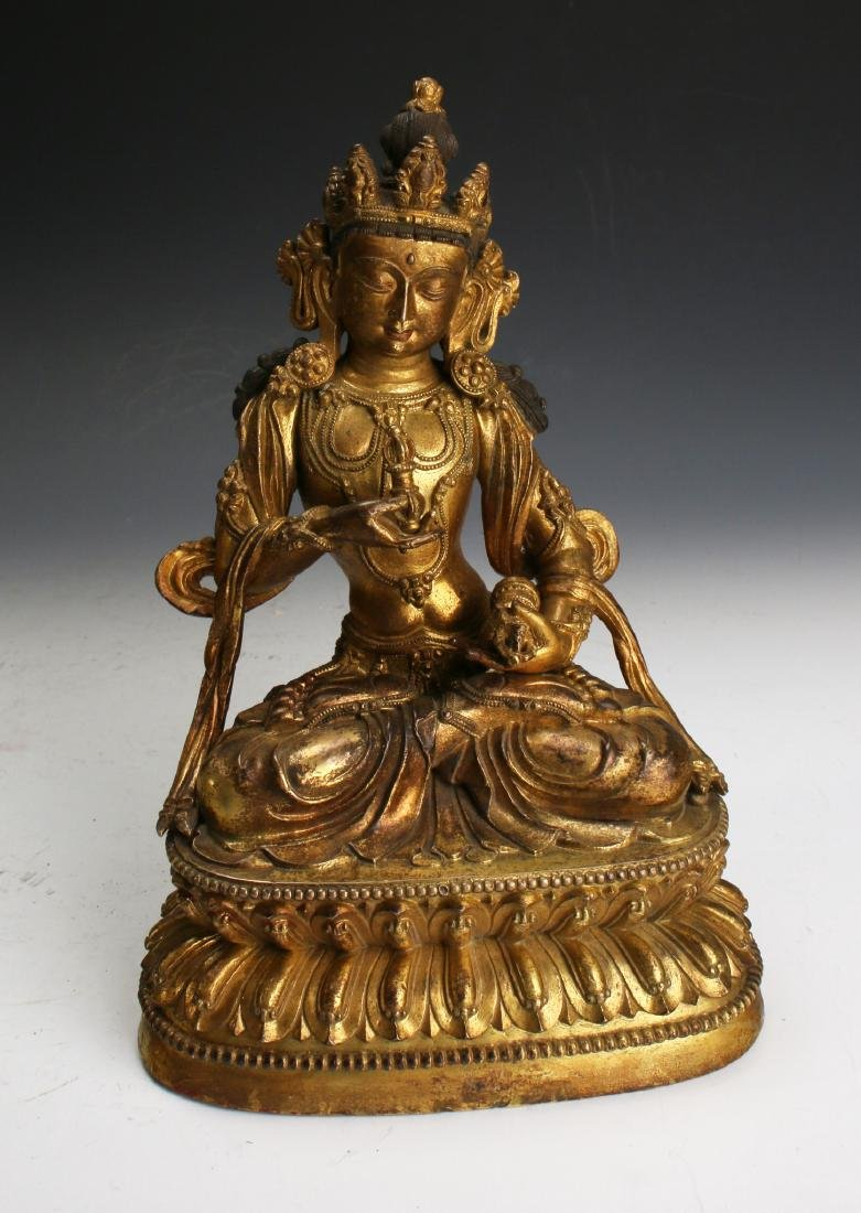 CHINESE MING DYNASTY GILT BRONZE BUDDHA